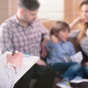 Family Therapy Parents and child in a therapy session
